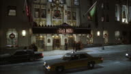 WS Essex House Hotel with street traffic / Manhattan, New York, USA