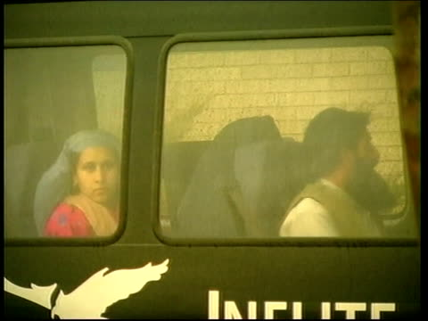 Essex Stansted Freed hostages looking from bus after release from hijacked Ariana Airlines aircraft