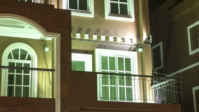 establishing shot : modern apartment window night scene