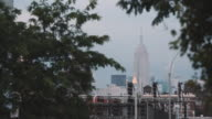 Establishing shot of New York City's Empire State Building on a cloudy afternoon.