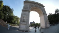 Establishing shot of New York City's Washington Square Park on a sunny afternoon