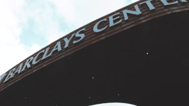 establishing shot of the entrance to Brooklyn's Barclays Center - 4k