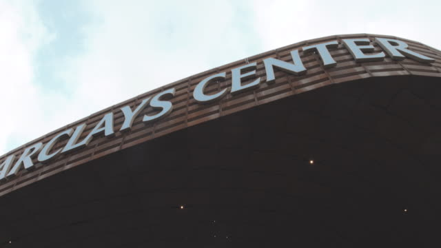 establishing shot to the entrance of Brooklyn's Barclays Center - 4k