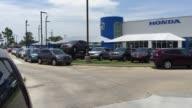 Establishing shots of a Honda Dealership