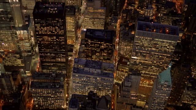establishment shot of cityscape metropolis skyline. aerial view of new york city at night