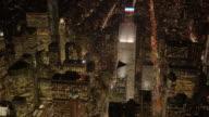 establishment shot of metropolis city skyline at night. urban landmarks background
