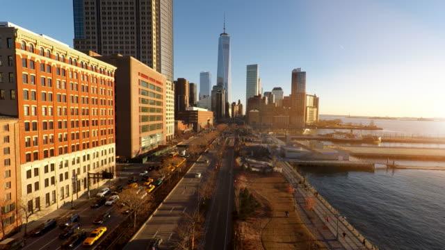 establishment shot of metropolis city skyline at sunset. urban landmarks background