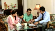 Estate agent dealing with a family, Delhi, India