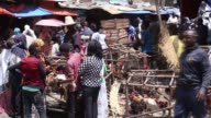 Ethiopian Orthodox Christians are seen at Sholla livestock market during the Holy Saturday ahead the Easter in Addis Ababa Ethiopia on April 15 2017...