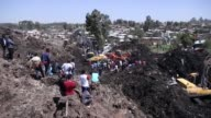 Ethiopian rescuers search for survivors and victims at the scene of a garbage landslide on the outskirts of Addis Ababa Ethiopia on March 12 2017