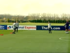 England prepare for friendly match against Austria Training McClaren kicking ball with other coaches / Beckham and Sol Campbell talking whilst...