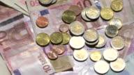 euro banknotes + coins
