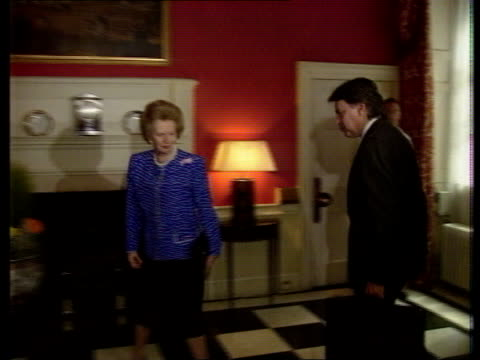 MEP's Thatcher INT ENGLAND London No 10 Downing St MS Spanish PM Felipe Gonzalez in through door of No 10 after PM Margaret Thatcher PULL OUT as...