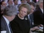 MEP's Thatcher INT GREECE Rhodes Margaret Thatcher Foreign Sec Sir Geoffrey Howe seated at meeting PULL OUT as waiter serves coffee to Howe TX