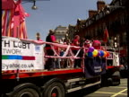Sir Ian McKellen interview Float with women in pink Tshirts dancing banners reading 'Roehampton University' and 'Wandsworth LGBT Community Network'...