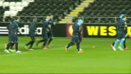 Napoli train at Swansea WALES Swansea Liberty Stadium Various of SSC Napoli football team taining on Swansea pitch watched by thier coach Rafa Benitez
