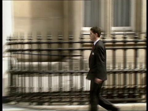Conservative party EXT Patrick Robertson along enters building