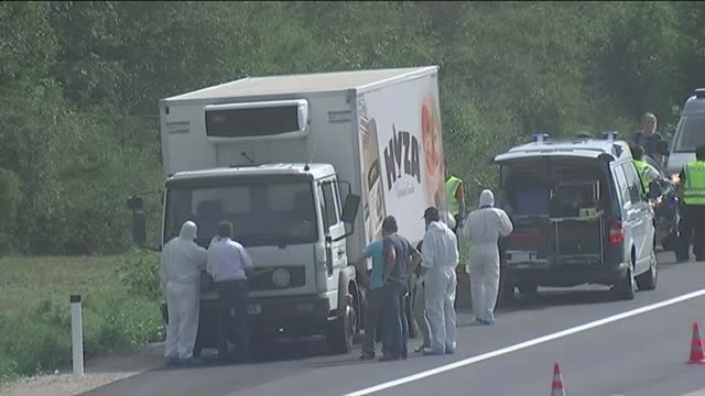 50 found dead in lorry AUSTRIA FORWARDs past Austrian police gathered around back of lorry GVs Lorry at side of motorway with police and forensic...