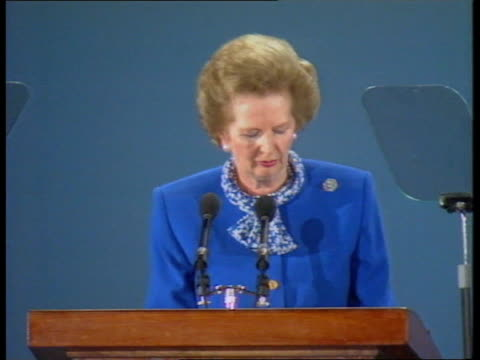 European Elections campaigning MS Margaret Thatcher MP at Conservative Party rally standing at lectern TMS Audience applauding SOF CMS Margaret...