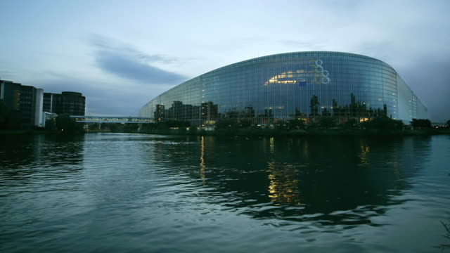 T/L, MS, European Parliament building across Marne-Rhine Canal, day to night, Strasbourg, France