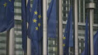 European Union Flag Stock Shots Exterior shots of European Union Flags Flag of Europe fluttering outside European Union EU Headquarters HQ in...