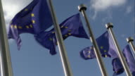 CU, LA, European Union flags flapping against clear sky, Brussels, Belgium