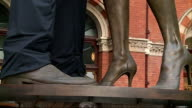 Eurostar unveil new uniforms for 20th anniversary ENGLAND London St Pancras International Station INT GVs of statue dressed in Eurostar's new uniforms