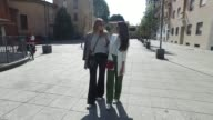 Eva Deusser wearing Zara trousers and blazer HM shirt Tiger of Sweden sneakers and Mykita sunglasses and Minu Pirzadeh wearing HM trousers and blouse...