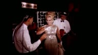 Eva Gabor Zsa Zsa Gabor's sister at 'JAMES BOND From Russia With Love' HOLLYWOOD movie premiere / Eva 'searched' by security at entrance to movie /...