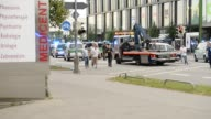 Evacuated peolple running away from mall on July 22 2016 in Munich Germany