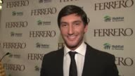 Evan Lysacek wishing everyone a divine holiday at the Ferrero Chocolates and Evan Lysacek Fashion Event at New York NY