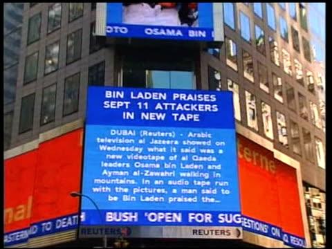 Eve of anniversary of September 11th terrorist attacks NAT ROBERT MOORE New York News videoscreen on side of building with 'Bin Laden praises sept 11...