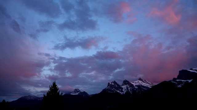 Evening clouds swirl around mountain peaks