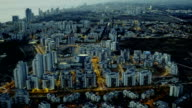 Evening coastal city. Panoramic aerial shooting