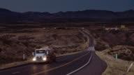 Evening Traffic on Lonely Desert Highway