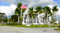 Everglades City Florida City Hall building founded  in 1928 in small village with US flag First Seat of Govermnment in Collier County