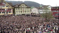 Every year thousands of people cram into the main square of Appenzell in north east Switzerland to vote for local leaders not by casting ballots but...