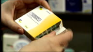 Fluoxetine capsules being taken from packet