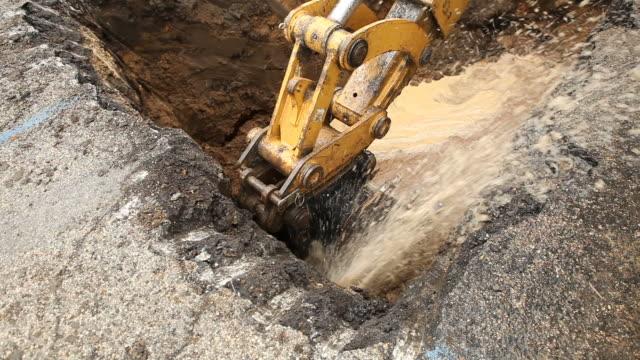 Excavator Bucket Caps a Broken Water Main