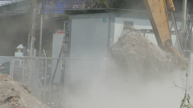 Excavator collect building waste at construction site