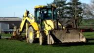 Excavator / Digger digging the ground
