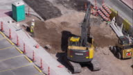 Excavator Digging on a Construction Site in Austin