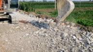 Excavator repair pavement.