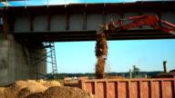 Excavator throws sand