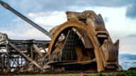 Excavator with Bucket Wheel in Brown coal surface mine.