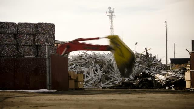 T/L WS Excavator working in recycling center / Salt Lake City, Utah, USA