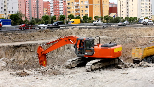 Excavator working on road
