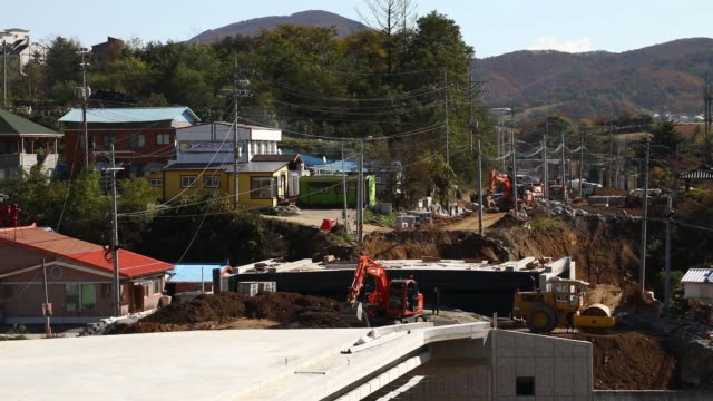 Excavators operate at a construction site in Hoenggyeri village area of Pyeongchang Gangwon South Korea on Friday Oct 20 Workers labor at a...