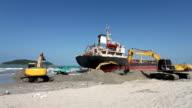 Excavators working on the beach