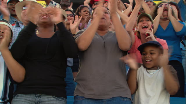 LA MS PAN Excited crowd clapping and cheering in bleachers / Homestead, FL, USA